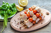 Chicken skewers with cherry tomatoes — Stock Photo