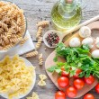 Various types of pasta with mushrooms and cherry tomatoes — Stock Photo
