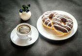 Chocolate donuts with a cup of coffee — Stock Photo