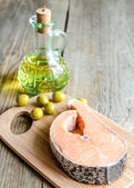 Food with unsaturated fats - salmon and olive oil — Stok fotoğraf