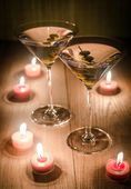Two olive martini cocktails in the candlelight — Stock Photo