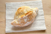 Loaf of white bread on the wooden table — Stock Photo