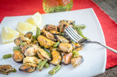 Fried mussels on the square plate — Stock Photo
