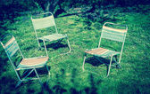 Three chairs on the lawn — Stock Photo