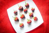 Fresh strawberries covered with dark chocolate — Stock Photo