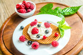 Belgian waffles with whipped cream and fresh berries — Стоковое фото