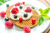 Belgian waffles with whipped cream and fresh berries — Photo