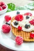 Belgian waffles with whipped cream and fresh berries — Stockfoto