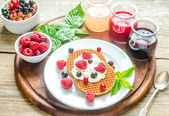 Belgian waffles with whipped cream and fresh berries — Stock fotografie