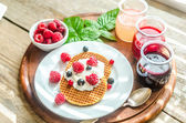 Belgian waffles with whipped cream and fresh berries — Stock Photo