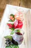 Currant jam with fresh berries on the wooden tray — Stock Photo
