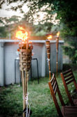 Burning tiki torch in the backyard — Foto Stock