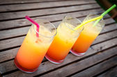 Three tequila sunrise cocktails — Stock fotografie