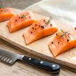 Raw salmon steaks on the wooden board — Stock Photo #51346585