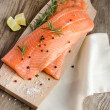 Raw salmon steaks on the wooden board — Stock Photo #51348859