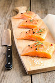 Raw salmon steaks on the wooden board — Stock Photo