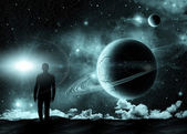 Man standing on the background of the cosmic landscape — Stock Photo