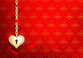 Een hart van goud op een rode achtergrond met een patroon — Stockfoto