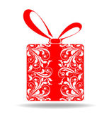 Red gift box with designs on a white background — Stock Photo