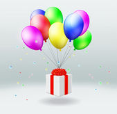 Gift box with flies on balloons — Stock Photo