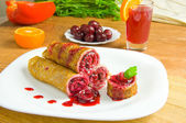Pancakes with cherry on a white plate — Stok fotoğraf