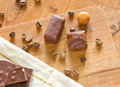 Chocolate and candy on wood background — Stock Photo
