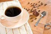 Black coffee in white cup and chocolate — Stock Photo
