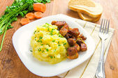 Mashed potatoes and grilled meat on a white plate — Stock Photo
