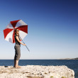 Girl With Umbrella At The Beach — Stock Photo