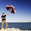 Man With Umbrella At The Beach — Stock Photo