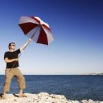 Man With Umbrella At The Beach — Stock Photo #23714063