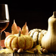 Pumpkins, red wine and autumn leaves — Stock Photo