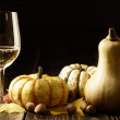 Pumpkins and autumn leaves with white wine — Stock Photo