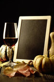 Pumpkins, red wine and autumn leaves — Стоковое фото