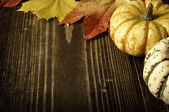 Pumpkins and autumn leaves — Stock Photo