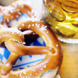 Stock Photo: Pretzel and beer on bavarinapkin