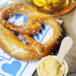 Pretzel, Obatzter and beer on bavarian napkin — Stock Photo #23734885