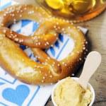 Pretzel, Obatzter and beer on bavarian napkin — Stock Photo