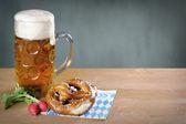 Masskrug beer, Pretzel and red radish — Stock Photo