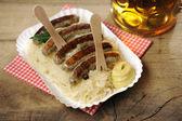 Sauerkraut and Nuernberger Bratwuerstchen — Stock Photo
