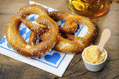Pretzel, Obatzter and beer on bavarian napkin — Stock Photo