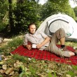 Camping serie: man resting in front of a tent — Stock Photo