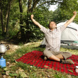Man stretching in front of a tent - camping serie — Stock Photo