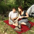 Couple dicussing hiking plans - camping serie — Stock Photo
