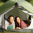 Couple in a tent, camping serie — Stock Photo