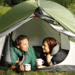 Couple lying in a tent, camping serie — ストック写真