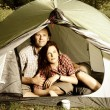 Couple lying in tent - camping serie — Stock Photo