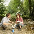 Couple preparing food outdoors - camping serie — Stock Photo #23866661