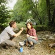 Couple preparing food outdoors - camping serie — Stock Photo #23866715
