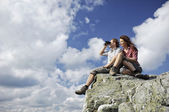 Two sitting on top of a mountain — Stock Photo